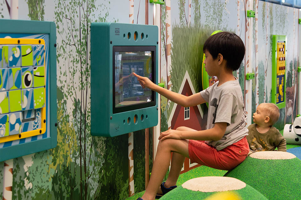 this image shows a kids corner with interactive play system